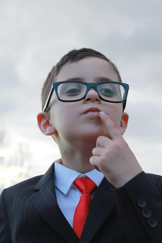 young genius child in smart suit