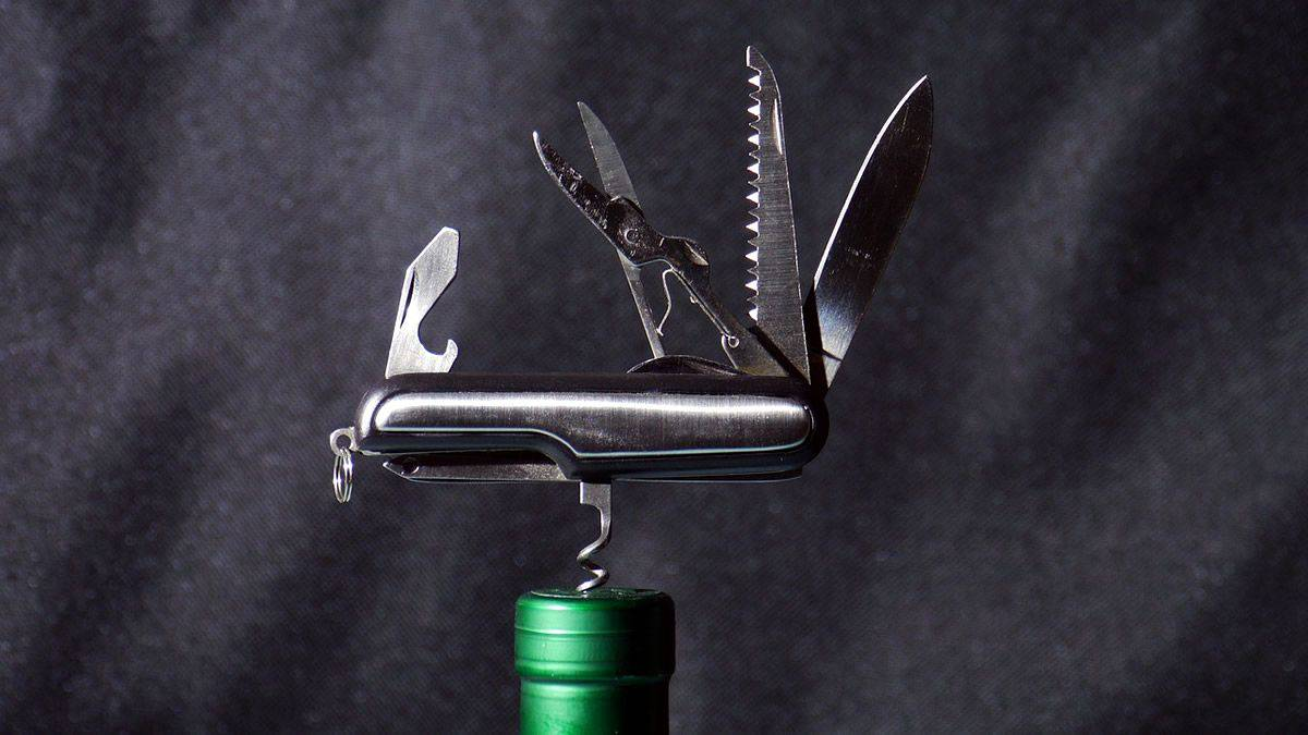 A multi-purpose tool set including corkscrew, knife, scissors, and bottle opener, just like tools for developers that aim to simplify every part of a development process.