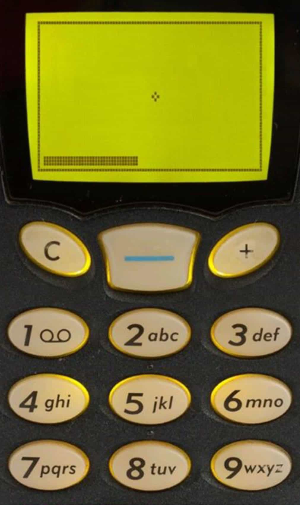 """A photo of the game """"Snake"""" on a monochromatic cell phone screen."""