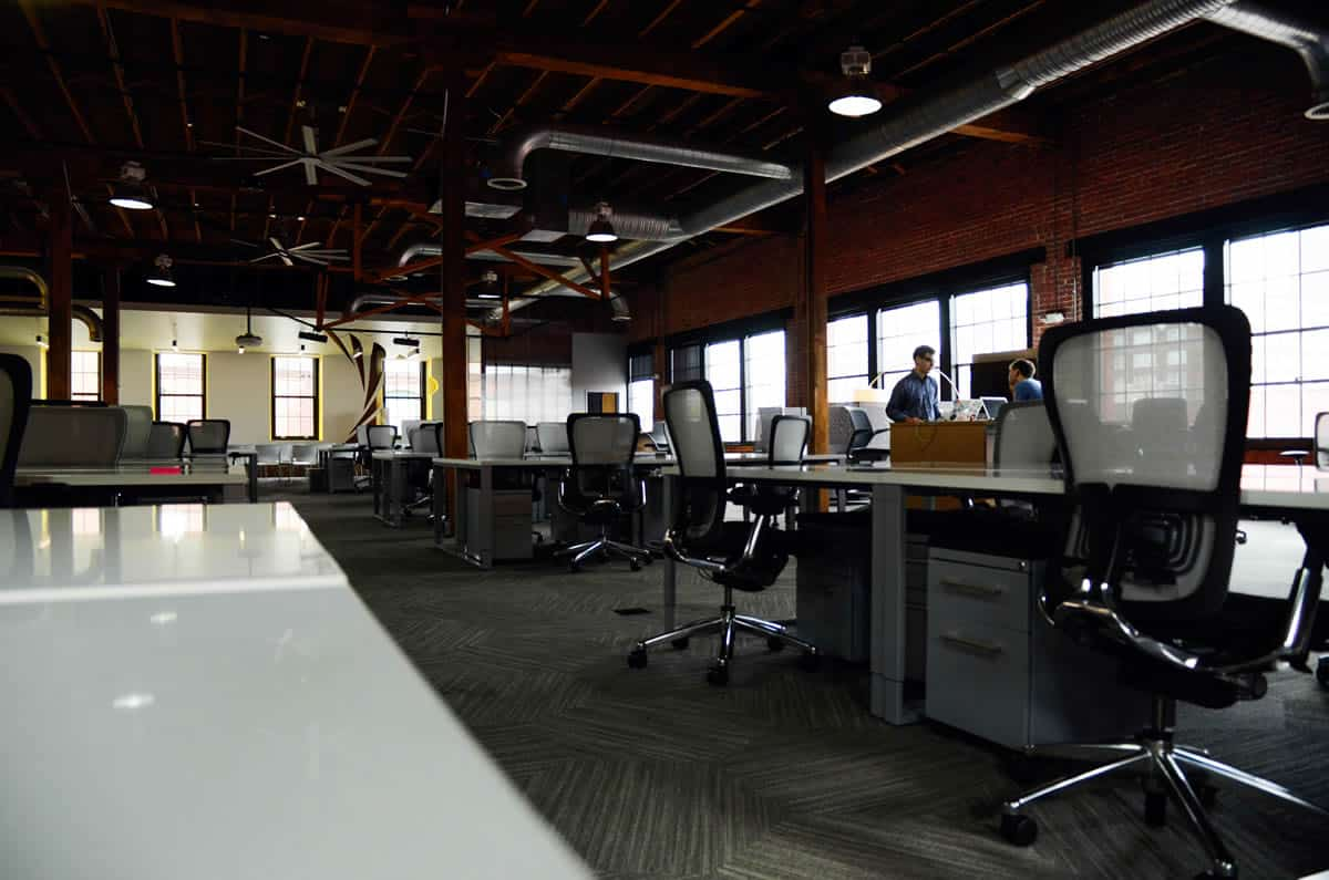 Image of desks and chairs in an office.