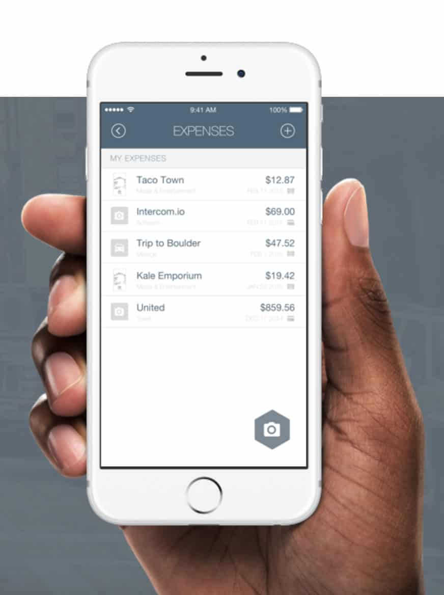 Image of a hand holding a mobile phone with the expense bot expenses page.