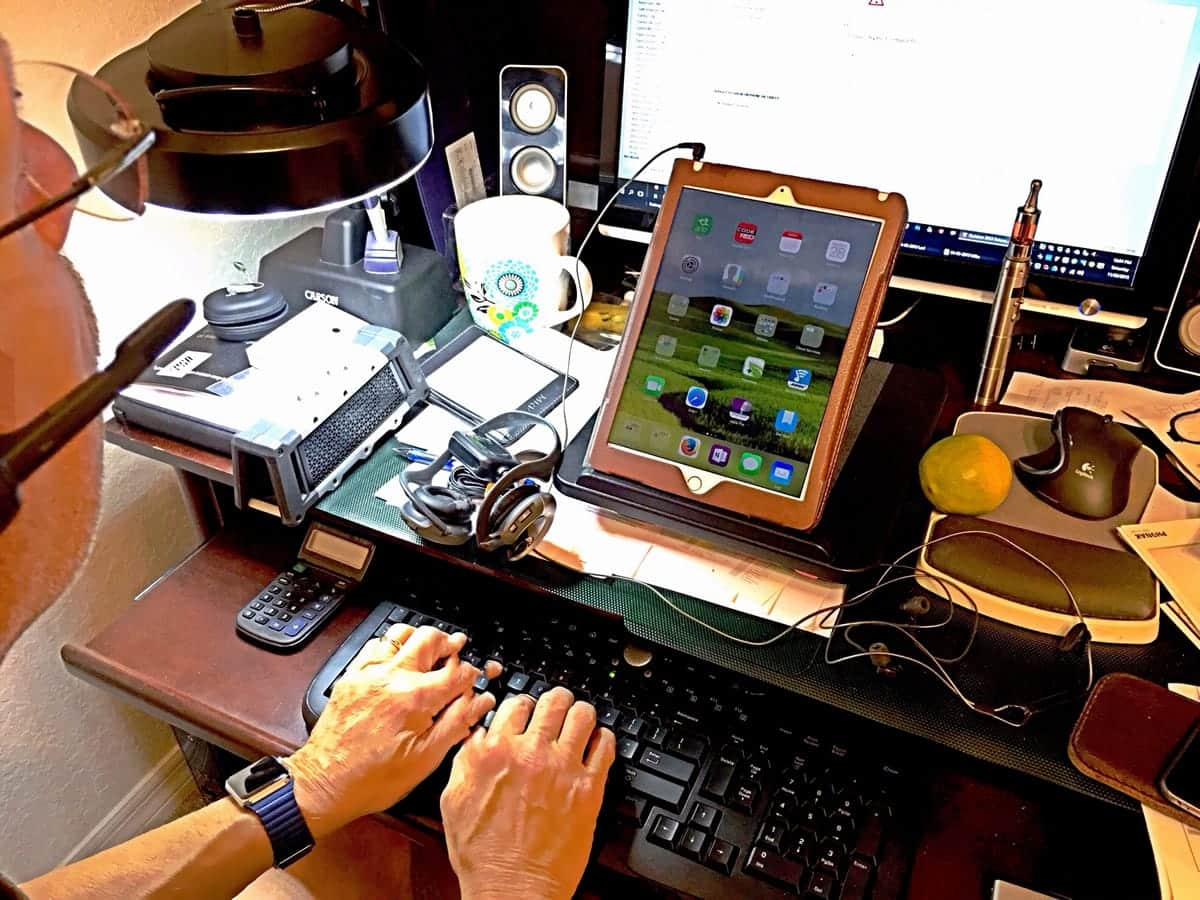 A man does work using a tablet.