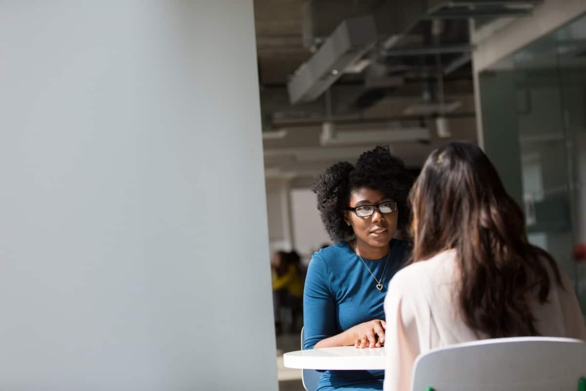Two women in an interview in an office.