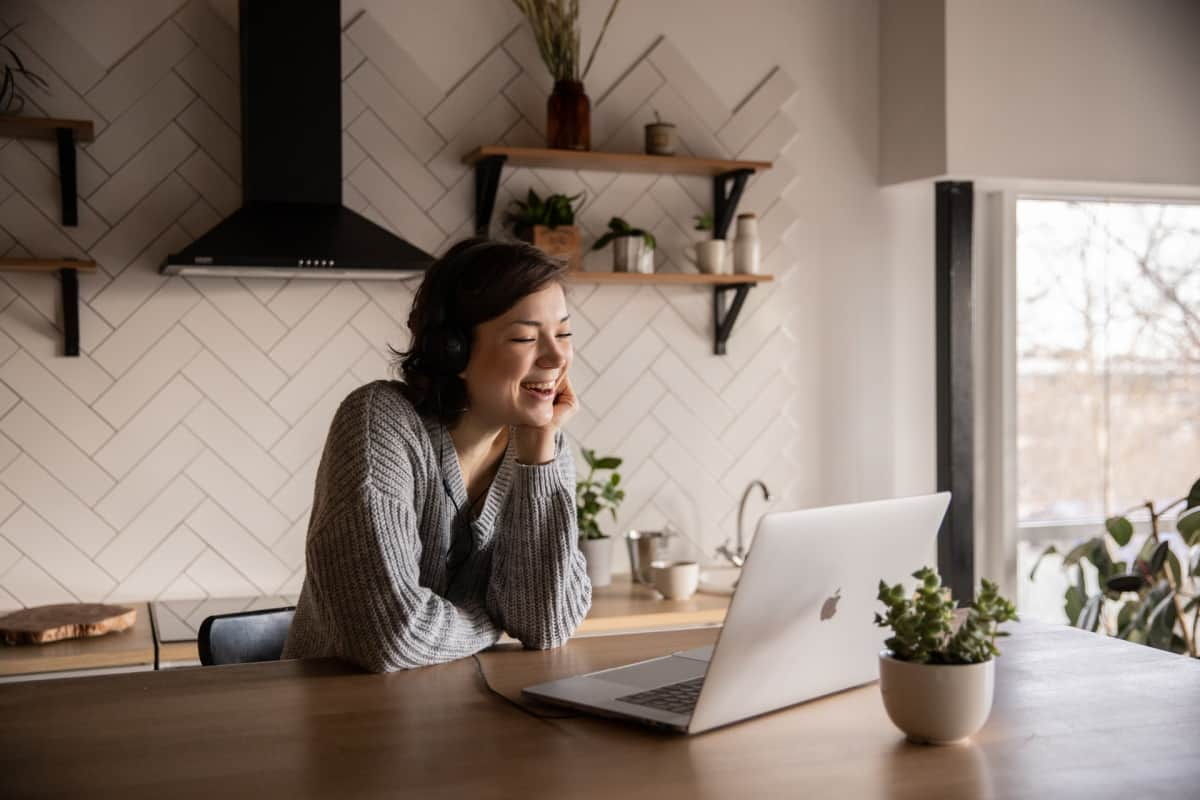 An employee taking a video call at home.